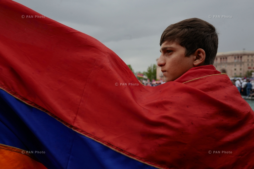 A teenager celebrating Nikol Pashinyan's election as PM at the Republic Square, 08.05.18
