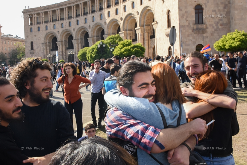 Demonstrators hug each other after hearing the news of Prime Minister Serzh Sargsyan's resignation, 23.04.2018