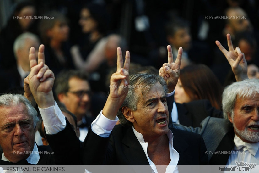 French philosopher and co-screenwriter Bernard-Henry Levy (C) and