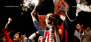 Armenian fans celebrate their team's victory over Bulgaria