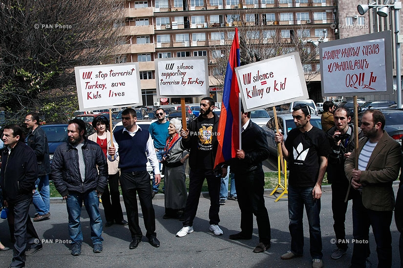 Armenian citizens hand a letter over recent developments in Syria's Kessab to UN office in Yerevan