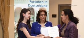 Deputy Head of Mission of the German Embassy Nadia Lichtenberger awards DAAD scholarship winners with certificates