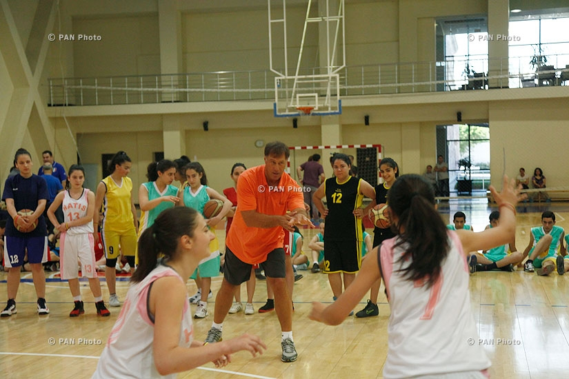 Legendary Lithuanian basketball player Sarunas Marciulionis holds a master-class for about 120 children