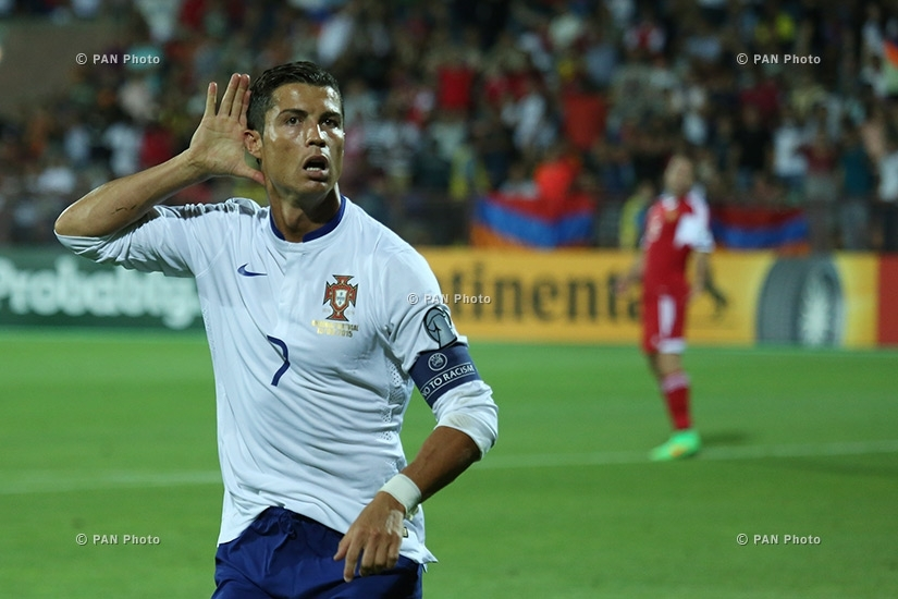 Portugal's Cristiano Ronaldo gestures after scoring the second goal during the Euro 2016 Group I qualifying match between Armenia and Portugal in Yerevan, Armenia