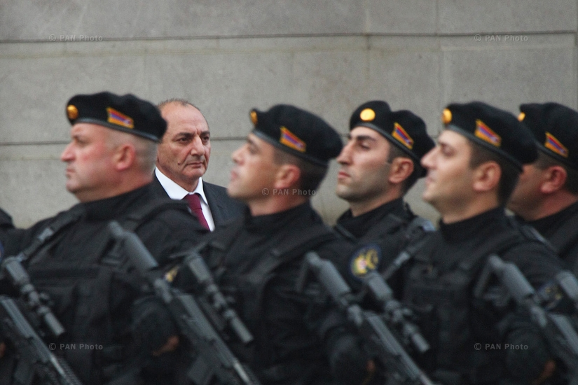 Bako Sahakyan, background, watches a parade following his inauguration ceremony as president in Stepanakert, Artsakh Republic