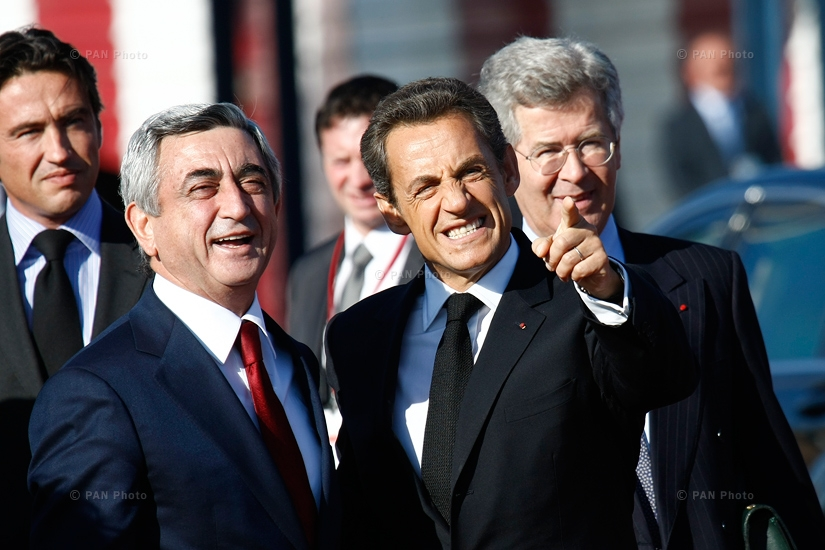 Former President of France Nicolas Sarkozy and President of Armenia Serzh Sargsyan smile while Sarkozy points at mount Ararat