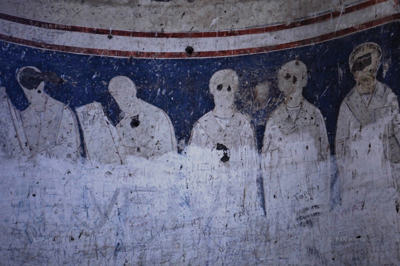 Icons on the walls of the ruined churches of Ani. Unidentified vandals have disfigured the eyes of the depicted saints