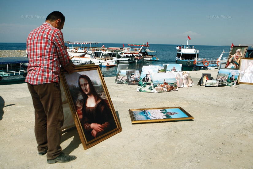 A painter sells his work on the shore of Lake Van. Tourists often visit this region and buy souvenirs from the locals