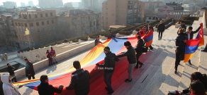 Activists take photos with Armenian flag to protest filming ban at Cascade