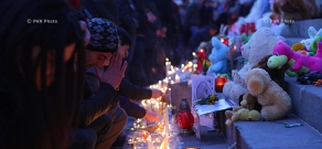 Candle lighting in memory of 6-month-old Seryozha Avetisyan in Liberty Square