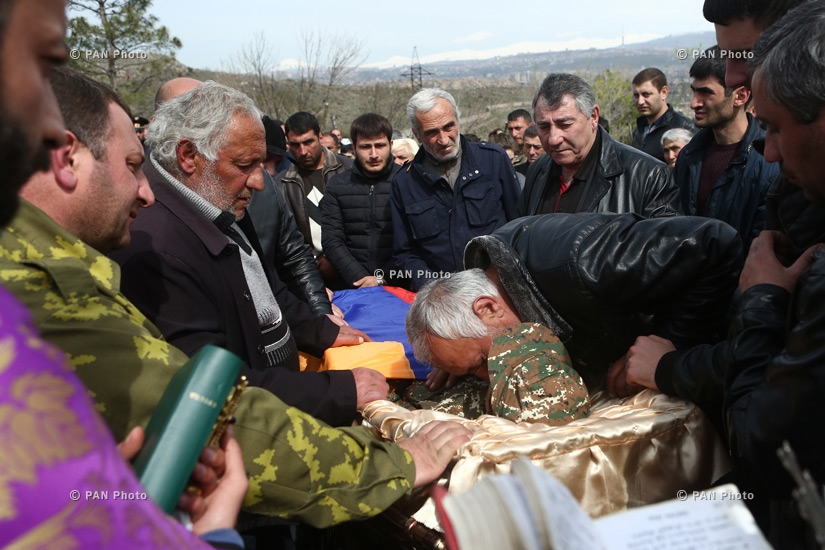 A man bids farewell to his son, contract serviceman Sasun Mkrtchyan, who was killed in the course of military operations on the line of contact between Nagorno Karabakh and Azerbaijan