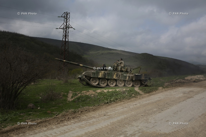 Armenian soldiers patrol on a tank near Mataghis village in the northeast of Nagorno-Karabakh