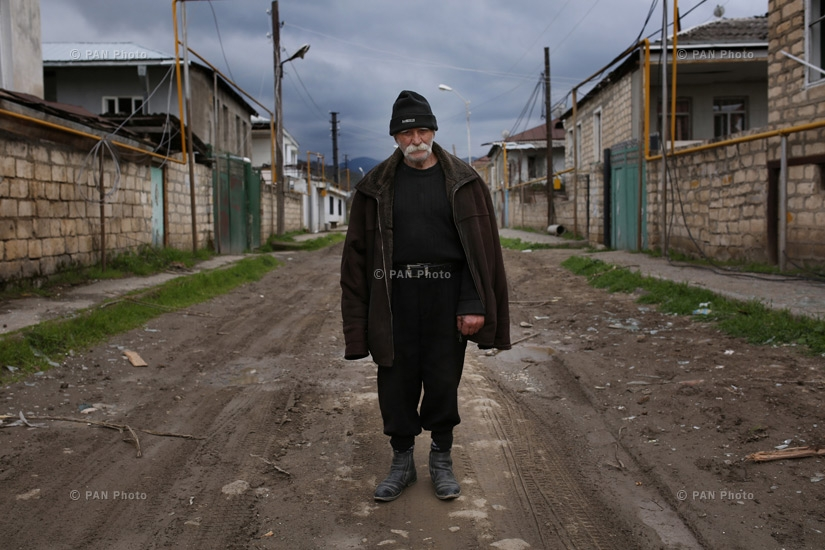 92 year-old Armenian man Vagho Beglaryan stands between abandoned and destroyed houses of Martakert town of Nagorno-Karabakh Republic