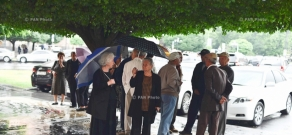 Residents  of Yerevan's 33rd district of Firdusi protest in front of government building