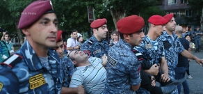 Police detain protesters outside seized patrol regiment in Yerevan. Day 11